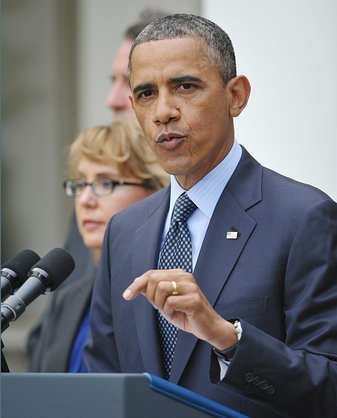 US President Barack Obama speaks on gun control as former US representative Gabby Giffords (L) watches on April 17, 2013 in the Rose Garden of the White House in Washington, DC. Credit: AFP/Getty Images